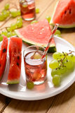 A drink of watermelon and grapes with ice cubes Royalty Free Stock Photos