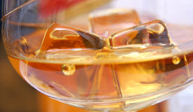 Drink of whiskey. With two ice cubes Stock Photo