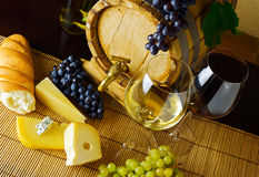 Wine and cheese on the table Stock Images