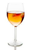 Drink in wine glass with ice cubes Royalty Free Stock Photography