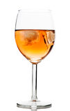 Drink in wine glass with ice cubes. On white background Stock Photography