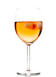 Drink in wine glass with ice cubes Royalty Free Stock Image
