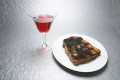 Drink in Wineglass and Raisin Toast. On Silver Grey Background Stock Image