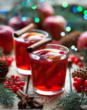 Drink on winter evening. Hot granberry orange pomegranate punch or mulled wine, sangria in a Christmas tree decorations. Stock Image