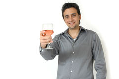 Drink Wisely. A man raises his glass to toast. Man isolated on white background. Man with a happy smile on his face holding a glass of wine out in front of him Stock Photography