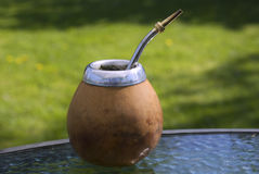 Drink of yerba mate. Bombilla - container for drinking of yerba mate Royalty Free Stock Images