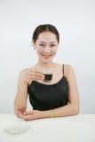 Drinkende vrouw stock afbeelding