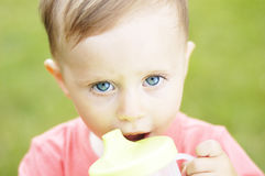 Drinker cute small boy on vacation Royalty Free Stock Images