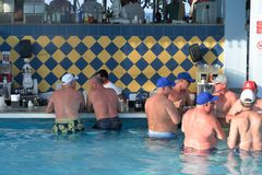 Drinkers at Swim up Bar Stock Photography