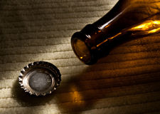 After drinking. A brown beer bottle and cork Royalty Free Stock Images