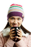 Drinking. A beautiful girl holding a cup of hot drink Stock Photos