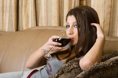 Drinking. Women drinks a red wine Stock Photo