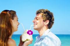 Drinking. A portrait of attractive couple having date on the beach Royalty Free Stock Image
