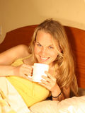 Drinking. Young happy smiling woman drinking coffee Stock Image