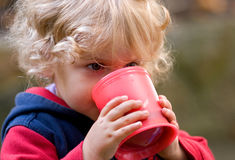 Drinking. Closeup-view of a drinking child royalty free stock images