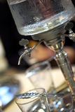 Drinking absinthe in a bar Royalty Free Stock Image