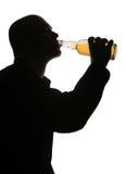 Drinking alcohol Stock Image
