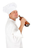Drinking alcohol chef Royalty Free Stock Photography