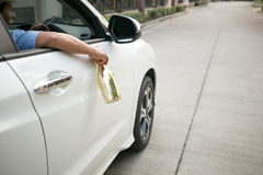 Drinking alcohol while driving Royalty Free Stock Image
