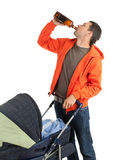 Drinking alcohol father with baby buggy Stock Image
