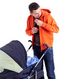 Drinking alcohol young father with baby stroller Royalty Free Stock Images