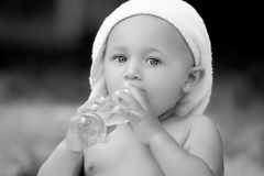 Drinking baby oil Stock Images