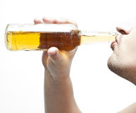 Drinking beer #2. Man drinking beer from bottle Stock Photography
