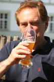 Drinking beer. Senior man drinking beer Royalty Free Stock Photo