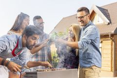Drinking beer at barbecue party stock image
