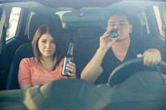 Drinking beer behind the wheel Royalty Free Stock Images