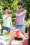 Drinking beer during garden party Royalty Free Stock Images