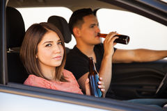 Drinking beer inside a car Stock Photos