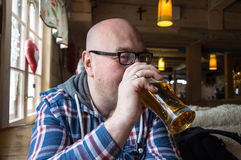A drinking beer Royalty Free Stock Image
