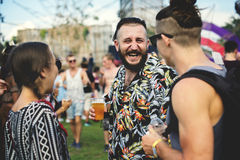 Drinking Beers Enjoying Music Festival together. Group of Friends Drinking Beers Enjoying Music Festival together stock photo