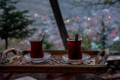 Drinking black turkish tea in the evening. Drinking turkish tea after the long work day Royalty Free Stock Photography