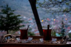 Drinking black turkish tea in the evening. Drinking turkish tea after the long work day Royalty Free Stock Image