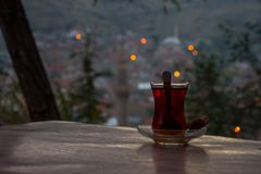 Drinking black turkish tea in the evening. Drinking turkish tea after the long work day Stock Photography
