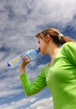 Drinking bottle of mineral water Royalty Free Stock Photos
