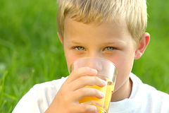 Drinking boy Royalty Free Stock Images