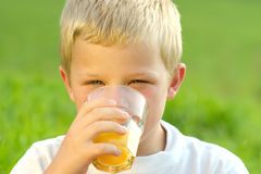 Drinking boy Stock Photo