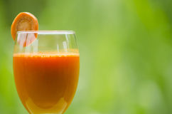 Drinking carrot juice has health benefits.  royalty free stock photo