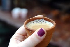 Drinking chai the traditional way stock image