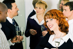 Drinking Champagne and celebrating in office Royalty Free Stock Images