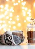 Drinking Christmas hot chocolate Stock Image