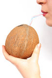 DRINKING COCONUT Royalty Free Stock Photography