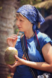 Drinking coconut juice Royalty Free Stock Photos