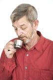 Drinking coffee. Senior man drinking coffee stock photo