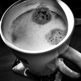 Drinking coffee. Artistic look in black and white. Stock Images
