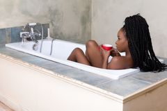 Drinking coffee in the bath tub royalty free stock images