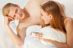 Drinking coffee in bed Stock Photos